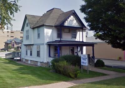 Original Teacher Store building on 606 5th Ave SE